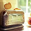 Stylish Chrome Toaster Popping Up Toast by Kelly Sillaste