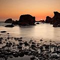 Sunset On A Rock by Keith Kapple