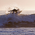 Surfer At Dusk Riding A Wave At Rincon by Rich Reid