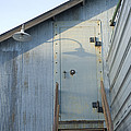 The Entry To A Metal Shed On A Sawmill by Joel Sartore