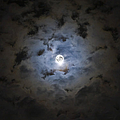 The Moon Covered By A Layer Of Clouds by Miguel Claro
