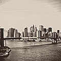 The New York City Skyline And The Brooklyn Bridge by Vivienne Gucwa