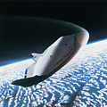 The Space Shuttle Re-entering The Earths Atmosphere by Stockbyte