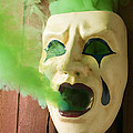 Theater Mask Spewing Green Smoke by Garry Gay