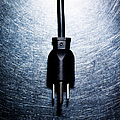 Three-pronged Electrical Plug On Stainless Steel. by Ballyscanlon
