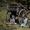 Two Girls Eat Lunch In A Hayfield by Clifton R. Adams