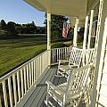 Two Rocking Chairs On A Sunlit Porch by Scott Sroka
