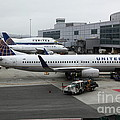 United Airlines At Foggy Sfo International Airport . 5d16937 by Wingsdomain Art and Photography