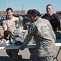 Us Army First Responders Use A Table by Everett