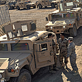 U.s. Army Soldier Speaks With Iraqi by Stocktrek Images
