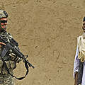 U.s. Army Specialist Talks To An Afghan by Stocktrek Images