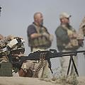 U.s. Marine Firing A Pk 7.62mm Machine by Terry Moore
