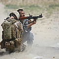 U.s. Marine Watches An Afghan Police by Terry Moore