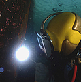 U.s. Navy Diver Welds A Repair Patch by Stocktrek Images