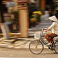 Vietnamese Woman Riding A Bicycle by Panya Jampatong