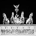 viktoria with quadriga on top of the Brandenburg gate at night Berlin Germany by Joe Fox