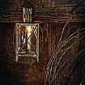 Vintage Lantern Hung In A Barn by Jill Battaglia