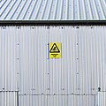 Warning Sign On An Industrial Building by Iain Sarjeant