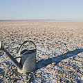 Water Pail On Dried Mud by Thom Gourley/Flatbread Images, LLC