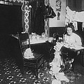 Woman Working In Basement, From Caption by Everett