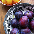 Yellow Cherry Tomatoes And Plums by Laura Johansen