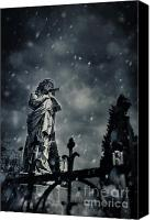 Spiritual  Winter Clouds Canvas Prints - Angel statue on graveyard Canvas Print by Nikolina Petolas