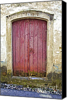 Medieval Special Promotions - Rustic Red Wood Door of the Medieval Village of Pombal Canvas Print by David Letts