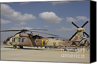 Featured Canvas Prints - A Line Of Uh-60l Yanshuf Helicopters Canvas Print by Ofer Zidon