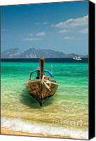Thai Canvas Prints - Moored Longboat Canvas Print by Adrian Evans