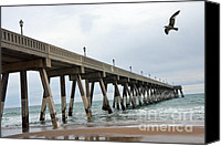 Beach Photos Canvas Prints - Surreal Beach Ocean Coastal Fishing Pier Seagull North Carolina Beach and Ocean Canvas Print by Kathy Fornal