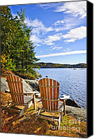 Lounge Canvas Prints - Adirondack chairs at lake shore Canvas Print by Elena Elisseeva