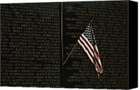 Veterans Memorial Canvas Prints - American Flag Left At The Vietnam Canvas Print by Medford Taylor