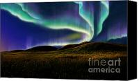 Aesthetic Canvas Prints - Aurora On Field Canvas Print by Atiketta Sangasaeng