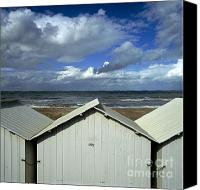 Thunderclouds Canvas Prints - Beach huts under a stormy sky in Normandy Canvas Print by Bernard Jaubert