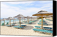 Lounge Canvas Prints - Beach umbrellas on sandy seashore Canvas Print by Elena Elisseeva