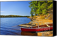 Vacation Canvas Prints - Canoe on shore Canvas Print by Elena Elisseeva