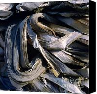 Materials Canvas Prints - Compressed pile of paper products Canvas Print by Bernard Jaubert