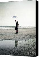 Puddle Canvas Prints - Girl on the beach with parasol Canvas Print by Joana Kruse
