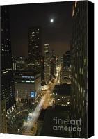 Shining Down Canvas Prints - Looking south on North Michigan Avenue in Chicago down on traffic on a moonlight night Canvas Print by Purcell Pictures