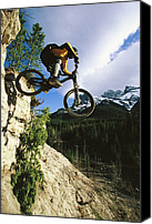 Athletes Canvas Prints - Man Jumping On His Mountain Bike Canvas Print by Mark Cosslett