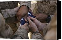 Commemorating Canvas Prints - Marines Fold An American Flag Canvas Print by Stocktrek Images
