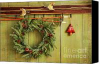 Xmas Canvas Prints - Old pair of skis hanging with wreath Canvas Print by Sandra Cunningham