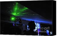 Nightclub Canvas Prints - People dancing and light effects in discotheque Canvas Print by Sami Sarkis