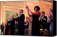 Obama Photo Canvas Prints - President And Michelle Obama Applaud Canvas Print by Everett