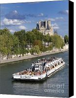 Ile De France Canvas Prints - Sightseeing boat on river Seine to Louvre museum. Paris Canvas Print by Bernard Jaubert