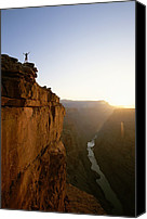 Gesturing Canvas Prints - A Hiker Surveys The Grand Canyon Canvas Print by John Burcham
