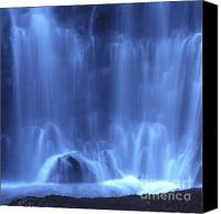 Moving Canvas Prints - Blue waterfall Canvas Print by Bernard Jaubert