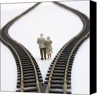 Consider Canvas Prints - Figurines between two tracks leading into different directions symbolic image for making decisions. Canvas Print by Bernard Jaubert