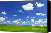 Saskatchewan Canvas Prints - Green rolling hills under blue sky Canvas Print by Elena Elisseeva