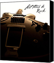 Gibson Guitar Canvas Prints - Let there be rock Canvas Print by Christopher Gaston